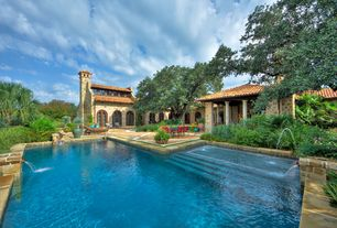 Mediterranean Swimming Pool with exterior stone floors, Pool with hot tub, Covered patio, French doors