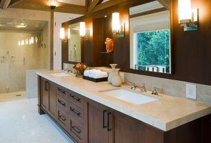 Contemporary Master Bathroom with frameless showerdoor, Flat panel cabinets, Flush, Undermount sink, Limestone, Double sink