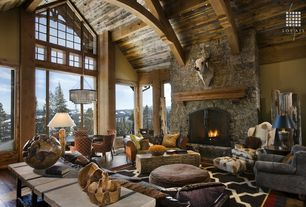 Eclectic Great Room with Ochre chainmail chandelier, Exposed wood ceiling, Exposed beam, Chandelier, Cathedral ceiling