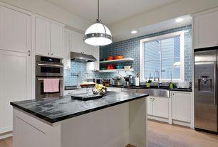 Contemporary Kitchen with full backsplash, Farmhouse sink, Pendant light, Casement, Standard height, can lights, Subway Tile
