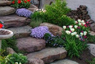 Traditional Landscape/Yard with Bird bath, exterior stone floors, Fence, Pathway