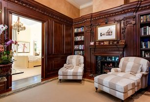 Traditional Home Office with High ceiling, stone fireplace, Crown molding, Chair rail, Hardwood floors, specialty door
