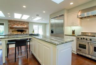 Traditional Kitchen with Marble countertops, Framed Partial Panel, double oven range, Kitchen island, Raised panel, One-wall