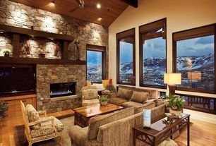 Craftsman Living Room with Bamboo roman shades, Ceiling fan, Hardwood floors, stone fireplace, Exposed beam, High ceiling