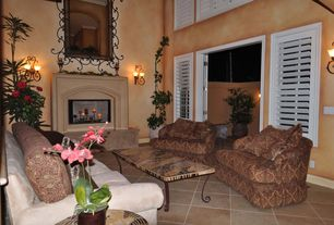 Mediterranean room with limestone tile floors, Wall sconce, Cement fireplace