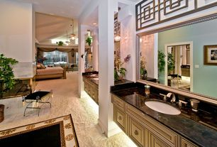 Traditional Master Bathroom with Complex Marble, Undermount sink, stone tile floors, Complex marble counters, Master bathroom