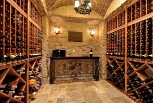Mediterranean Wine Cellar with Standard height, complex granite floors, Chandelier, Wrought iron console table