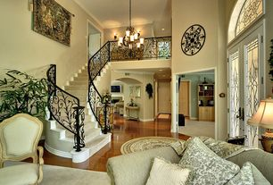 Traditional Staircase with High ceiling, French doors, Laminate floors, Crown molding, curved staircase, Chandelier