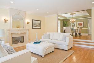 Modern Living Room with Crown molding, Hardwood floors, Carpet, Sunken living room, Chandelier