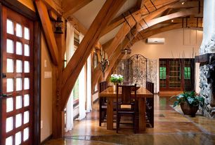 Rustic Dining Room with flush light, specialty door, Pendant light, Hardwood floors, Exposed beam
