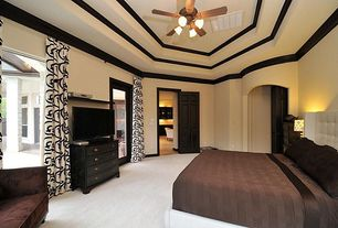 Modern Master Bedroom with Crown molding, flush light, Ceiling fan, Carpet, French doors