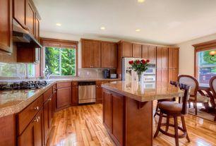 Craftsman Kitchen with picture window, Inset cabinets, full backsplash, L-shaped, Hardwood floors, Flat panel cabinets