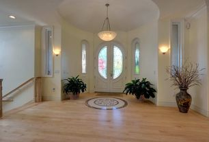 Traditional Entryway with Pendant light, Wall sconce, High ceiling, can lights, Laminate floors, Casement, Arched window