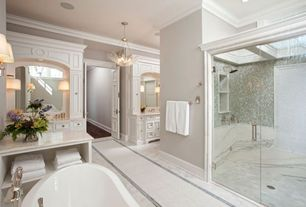 Traditional Master Bathroom with Crown molding, Chandelier, Complex marble counters, picture window, Inset cabinets, Bathtub