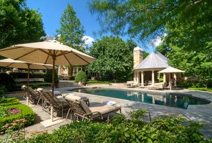 Traditional Swimming Pool with exterior stone floors, Fence, Other Pool Type, Gazebo, Pathway