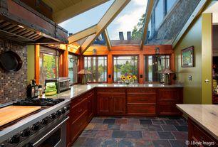 Craftsman Kitchen with Quartz countertop, slate tile floors, Kitchen island, Skylight, Daltile saddle 1 x 1 random sa56