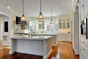 Traditional Kitchen with full backsplash, Kitchen island, Pendant light, Marble Vessel Top in Carrara, Standard height