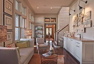 Contemporary Living Room with Aidan Gray Round Wrought Iron Coffee Table, Hardwood floors, Crown molding, Ceiling fan