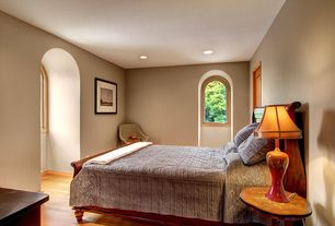 Mediterranean Guest Bedroom with can lights, Hardwood floors, Standard height, Arched window