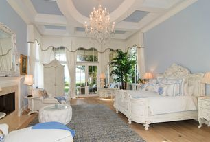 Traditional Master Bedroom with Pine flooring, picture window, Box ceiling, Wall sconce, Chandelier, Crown molding, Paint