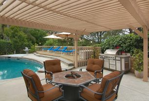 Craftsman Patio with Fire pit, exterior stone floors, Deck Railing, Fountain, Outdoor kitchen, Trellis, Raised beds