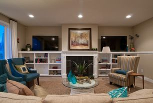 Contemporary Living Room with stone fireplace, Built-in bookshelf, Laminate floors