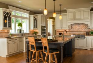 Traditional Kitchen with Custom hood, Simple granite counters, L-shaped, Stone Tile, Kitchen island, Raised panel, Flush