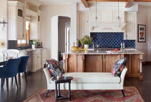 Eclectic Kitchen with Custom hood, Undermount sink, Simple granite counters, Glass panel, Pendant light, U-shaped, Casement