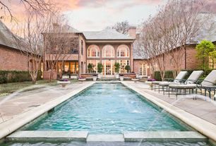 Traditional Swimming Pool with Raised beds, Fountain, Fence, Pathway, Arched window, exterior stone floors, French doors