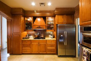 Traditional Kitchen with full backsplash, Raised panel, limestone tile floors, Simple granite counters, can lights, L-shaped