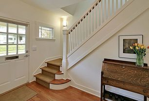 Traditional Entryway with High ceiling, Glass panel door, Wall sconce, Hardwood floors