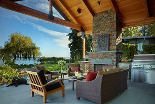 Contemporary Porch with Outdoor kitchen, Wrap around porch, exterior tile floors, exterior concrete tile floors