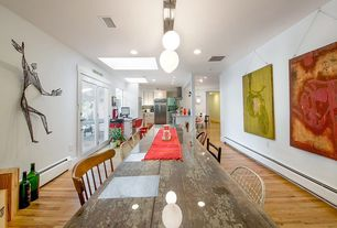 Eclectic Dining Room with Hardwood floors, Standard height, Pendant light, can lights, French doors