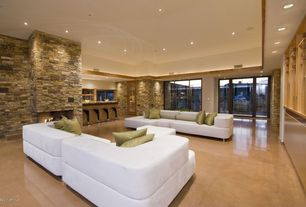 Modern Living Room with Stacked stone wall, picture window, can lights, Urban Leather Left- Chaise Sectional, Fireplace