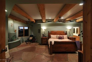 Rustic Guest Bedroom with can lights, Exposed beam, slate floors, High ceiling, Ceiling fan, Wall sconce, Cement fireplace