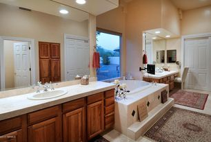 Traditional Master Bathroom with stone tile counters, Sandstone, Flush, Bathtub, Raised panel, partial backsplash, can lights