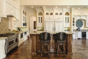Traditional Kitchen with Kitchen island, L-shaped, Raised panel, Glass panel, Oversize clock, Hardwood floors, Inset cabinets