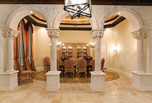 Mediterranean Dining Room with Crown molding, travertine floors, Wall sconce, Columns, can lights, High ceiling, Chandelier