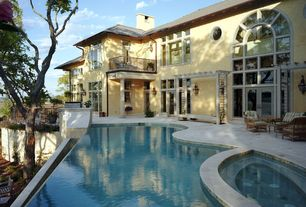 Modern Swimming Pool with Pathway, exterior tile floors, Arched window, Pool with hot tub, Transom window, Outdoor kitchen