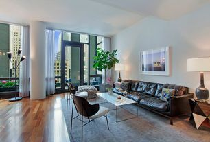 Contemporary Living Room with Transom window, Hardwood floors, Standard height, Columns, French doors, picture window