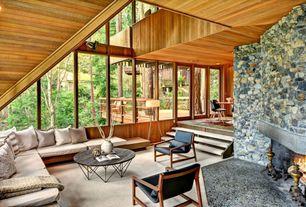 Craftsman Living Room with Fireplace, flush light, Standard height, stone fireplace, Carpet, Sunken living room, can lights