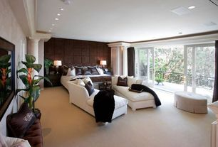 Traditional Master Bedroom with Fireplace, Carpet, Crown molding, sliding glass door, Interior columns, interior wallpaper