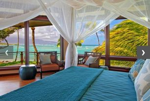 Tropical Master Bedroom with Laminate floors, picture window, Standard height, Strand woven mahogany bamboo flooring