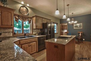 'Traditional Kitchen with MS International Santa Cecelia Granite, Pendant light, L-shaped, Complex Granite, Ceramic Tile' from the web at 'http://photos1.zillowstatic.com/i_f/IS1nq2efe16mij0000000000.jpg'
