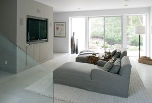 Modern Home Theater with picture window, Concrete floors, Restoration hardware: belgian track arm slipcovered chaise