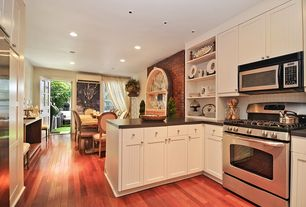 Modern Kitchen with Soapstone counters, Flush, Galley, Flat panel cabinets, Large Ceramic Tile, Glass panel door