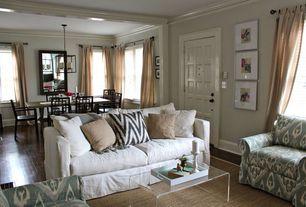 Contemporary Living Room with specialty door, Chandelier, Hardwood floors, Exposed beam, Crown molding