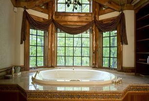 Rustic Master Bathroom with drop in bathtub, Bay window, Granite bathtub deck, Built-in bookshelf, Bathtub, Chandelier