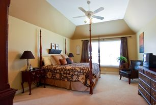Traditional Master Bedroom with Ceiling fan, Built-in bookshelf, Carpet