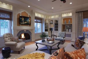 Traditional Living Room with stone fireplace, Casement, Ceiling fan, terracotta tile floors, Roman shades, can lights